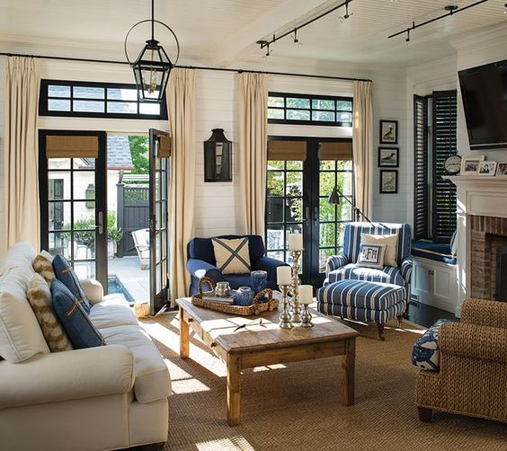 The living room's navy-and-white decorating scheme is nautically inspired. High-gloss finishes are reminiscent of a classic yacht.