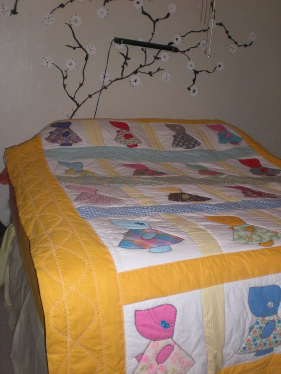 my first official quilt where I actually quilted, I loved my grandmothers sunbonnet sue quilt growing up so i made one, Its a lot of work but so worth it,,,