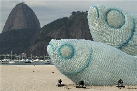 Giant fish made with plastic bottles are exhibited at Botafogo beach, in Rio de Janeiro via @reuters #RioPlus20