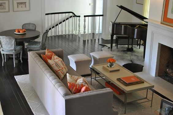 Gray And Orange Living Room Features A Gray High Back Sofa Adorned With  Orange Pillows Facing A Gray Coffee Table And A Pair Of Dove Grey Ottomans U2026