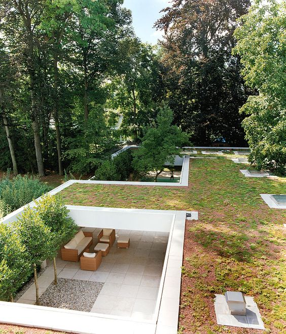 Modern house with zen garden and green roof architecture for Rooftop landscape design