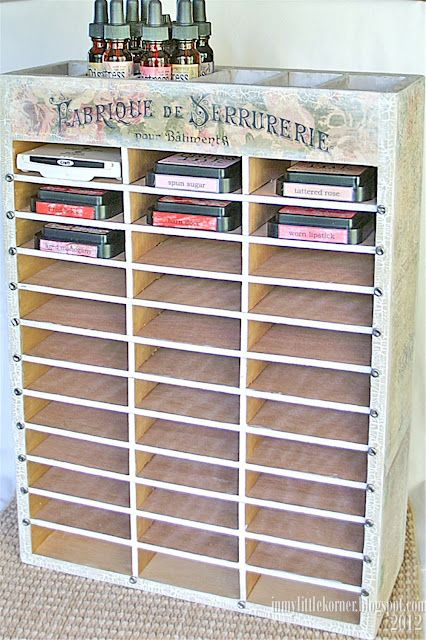 Storage for ink pads and refill bottles...plywood and luaun with paint, crackle, and decoupage accents.