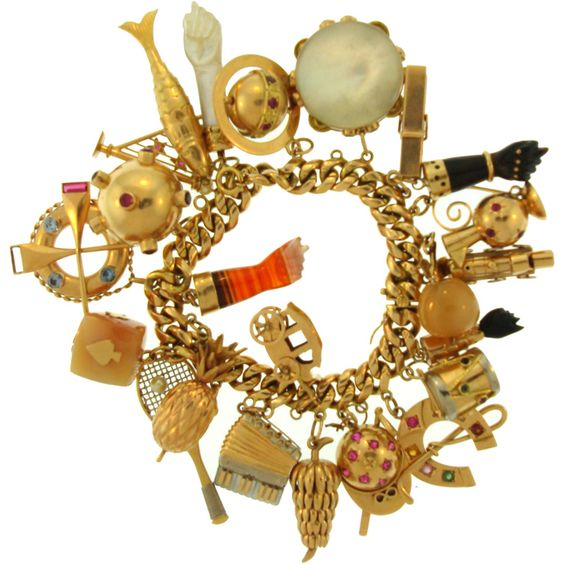 The most gorgeous vintage gold charm bracelet ever...: