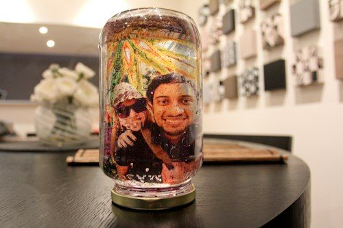 Transform your favorite photo into a Christmas snow globe! Print it onto a transparency and just add glitter and water!