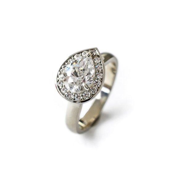 Custom pear shape diamond ring in 14k white gold.