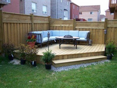 Love this... so simple, but useful! Those potted plants need either nicer pots, or to be planted. :) I might have even been as bold to paint some of the beams of the fence behind the couches.