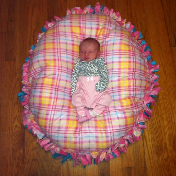 No sew floor pillow ... Made just like the no sew blankets just in a circle and stuffed with polyfil :) great baby shower gift :)