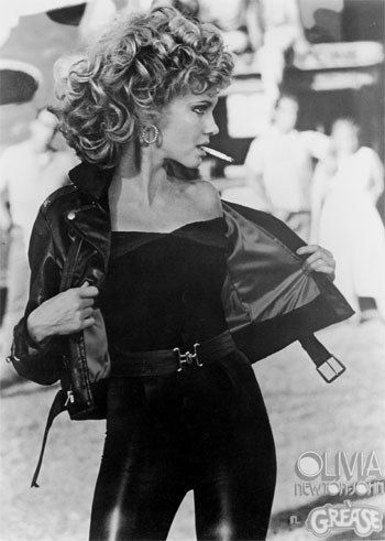 """Olivia Newton-John had to be sewn into the black leather pants for the carnival scenes. 