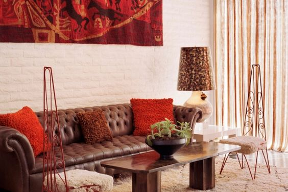 Covering a seat cushion is as easy as pie, so don't get stuck thinking about common fabrics. At the Parker Palm Springs, Jonathan Adler used a textural lambswool on a pair of playful wire seats for a bohemian-modern vibe.