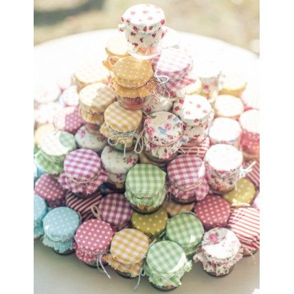 Centrepiece AND wedding favour idea - create a tower of homemade jams, chutneys or marmalades in the middle of each table.