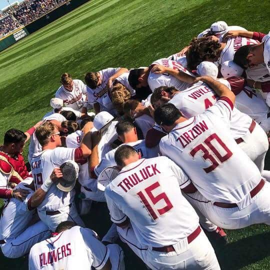 FSU Baseball Team Saying Their Prayers