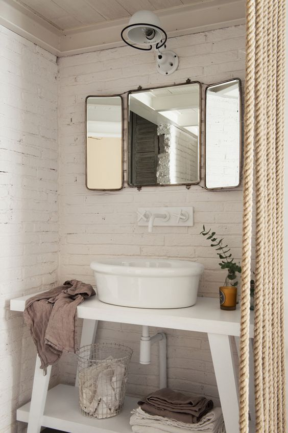There are plenty of beautiful apartments on the internet to drool over, but  this one takes the cake. With minimalist decor and white brick walls, this  urban abode is boasting with timeless style. We're swooning over the rustic  kitchen and the stand-alone bathtubin the bedroom! What's your favorite  part about this perfect apartment?
