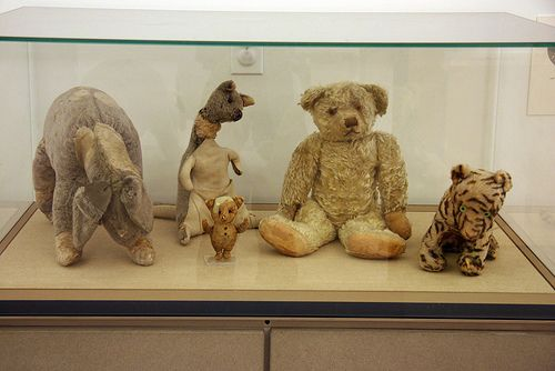 """Pooh and his friends were given as gifts by author A. A. Milne to his son Christopher Robin Milne between 1920 and 1922. Pooh was purchased in London at Harrods for Christopher's first birthday. Christopher later gave them to publisher E. P. Dutton, who in turn donated them to the New York Public Library."