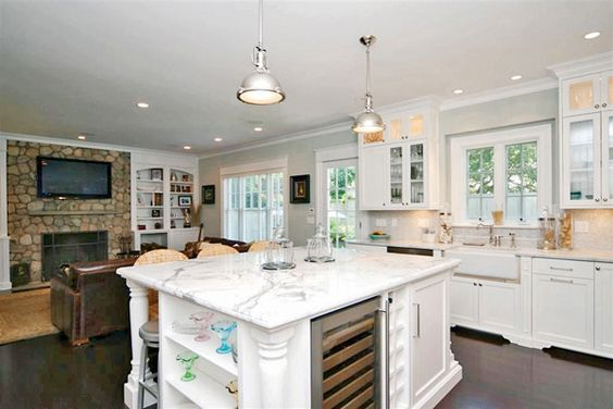 The kitchen, with its Vermont white granite countertops, is open to the living room.  Love island.