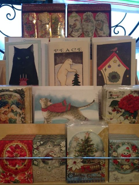 We have a nice selection of Christmas and Holiday cards in many styles, with & without glitter!  Sold boxed or by the each! :)