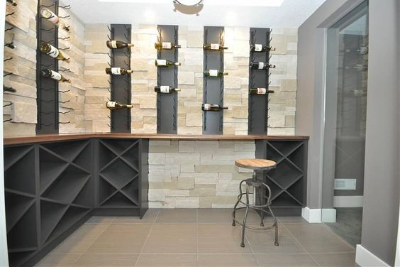 A mix of modern, metal racks and traditional wood racks really make a space pop. Find this and more at WineRacks.com
