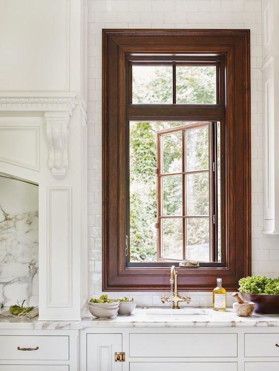 Wide stained wood trim around window gorgeous jackbilt for Window design center