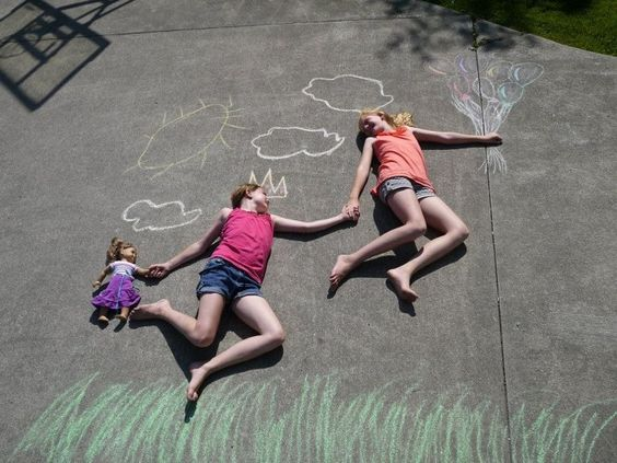 Super fun! Draw a picture with have someone lay down near it then take a pic from a ladder