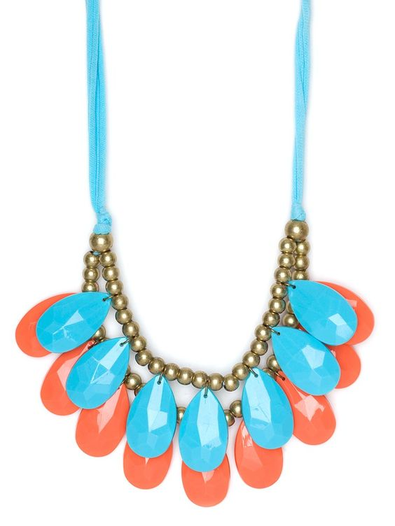 When it comes to color, the combo of turquoise and tangerine results in one thing: destination vacation. Case in point: this striking statement necklace, which, with its two tiers of gems in those bright hues, radiates an intense tropical vibe.