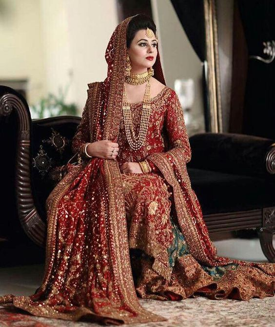 Embroidered Red and golden lehnga for brides