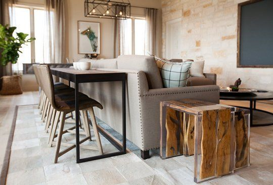 """I like the idea of a """"sofa table"""": When a sofa is floated in a room, place a table of the same height behind it to make it into a functional area and less of a visual roadblock. I like it with chairs--becomes a great spot to watch TV while doing work.:"""