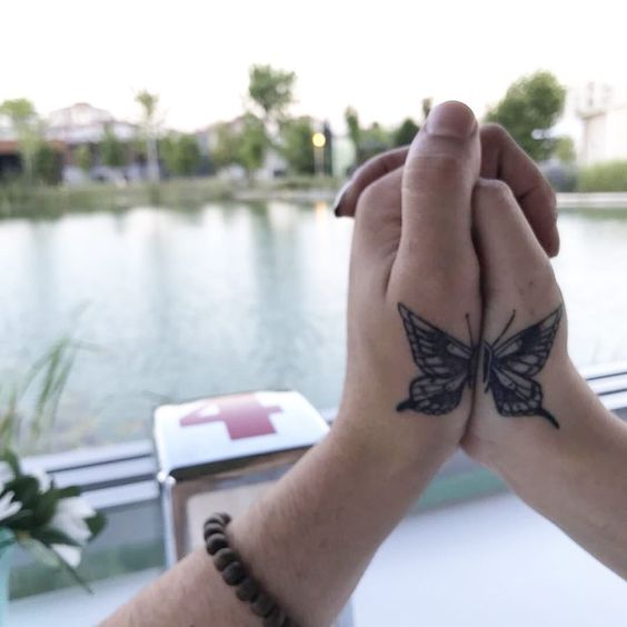 A pair of butterflies- 27 matching tattoos for couples that last longer than a ring - OurMindfulLife.com