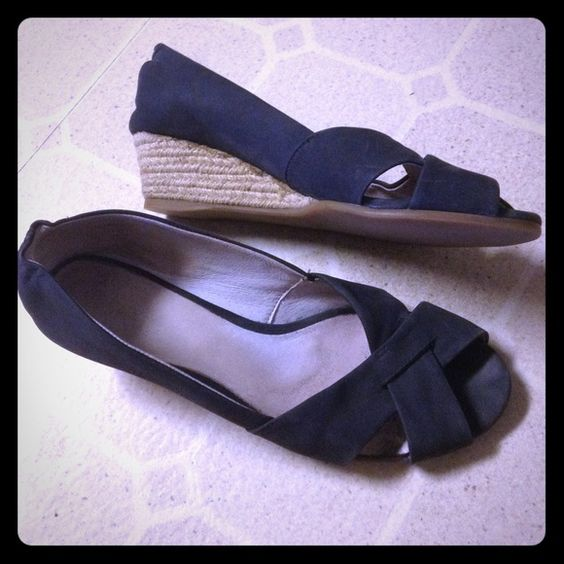 Clarks wedge sandals Clarks wedge sandals. Excellent used condition. Minimal wear on soles. Approx. 1.5 inch heel. Clarks Shoes Sandals