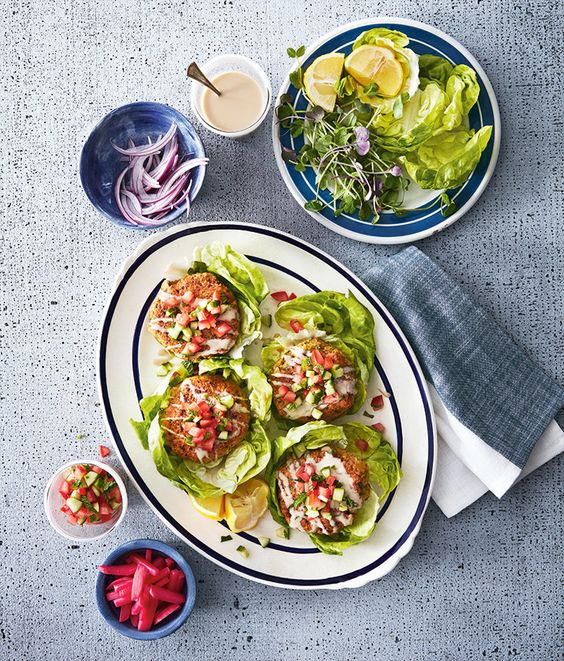 Serving these super-size falafel in lettuce leaves makes them extra-light (and gluten-free!), but if you don't mind the extra calories, use pitas or hamburger buns. Customize the toppings to your taste—sprouts, thinly sliced red onion and pickled tu