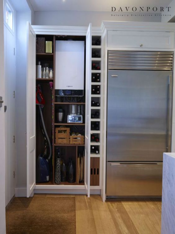 The utility cupboard hides the boiler and vacuum cleaner for Kitchen unit for boiler