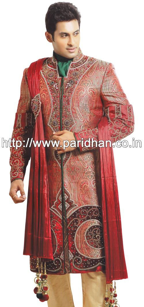 Lavish look wedding sherwani made from maroon color brocade fabric. Hand embroidered as shown. It has bottom as chudidar made from dupion silk fabric in light golden color.