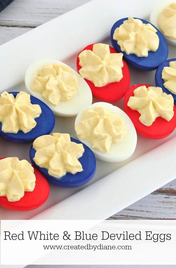 It's no summer cookout without deviled eggs, and this patriotic batch will be a huge hit at your 4th of July celebration. #4thofjuly #4thofjulyideas #4thofjulyparty #4thofjulyfood #4thofjulyrecipes #fourthofjuly #fourthofjulyfood #summerrecipes