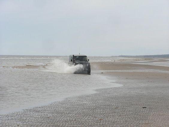 Land Rover Defender 110 driving along White Sea coast