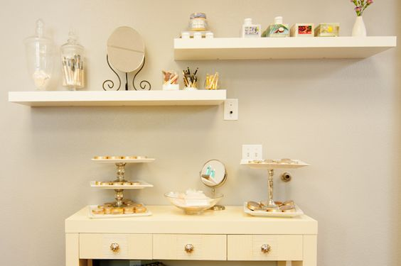 Cake stands fashioned from candlesticks and plates keep lots of compacts organized.