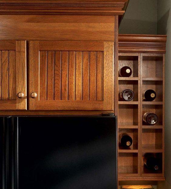 Wine rack cabinet wall wine racks and wine racks on pinterest for Kraftmaid storage solutions