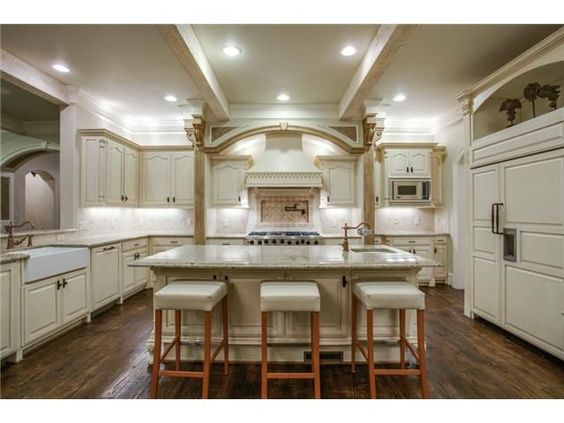 Incredible kitchen // Tons of cabinetry // Farmhouse sink // Island with seating // Light counters and cabinets