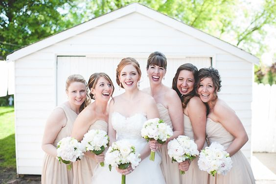 Lovely neutral bridesmaid dresses and white bouquets - photo by Jennifer Moher Photography | junebugweddings.com