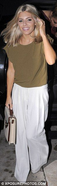 Gorgeous: Mollie King (L) wore a pair of wide legged white trousers with and olive top,
