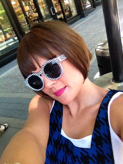 Willy Wonka brunette bob with bangs and stripy sunnies sunglasses fuchsia lip