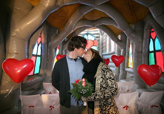 """Berlin — Pia Walter and Maxence Lepesant kiss in an inflatable """"pop-up"""" church during their wedding rehearsal.... An inflatable church!!!! Awesome!!!"""