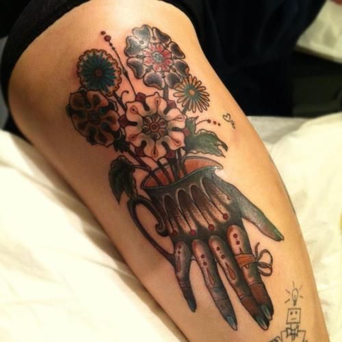 Tattoo with victorian (?) hand & flowers, mostly black/grey