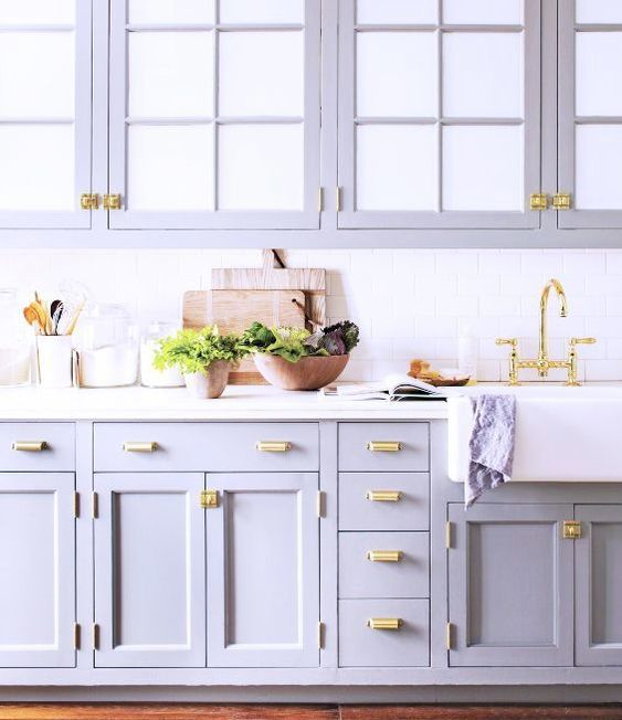 Lavendar and white kitchen. Brass hardware. This is gorgeous.