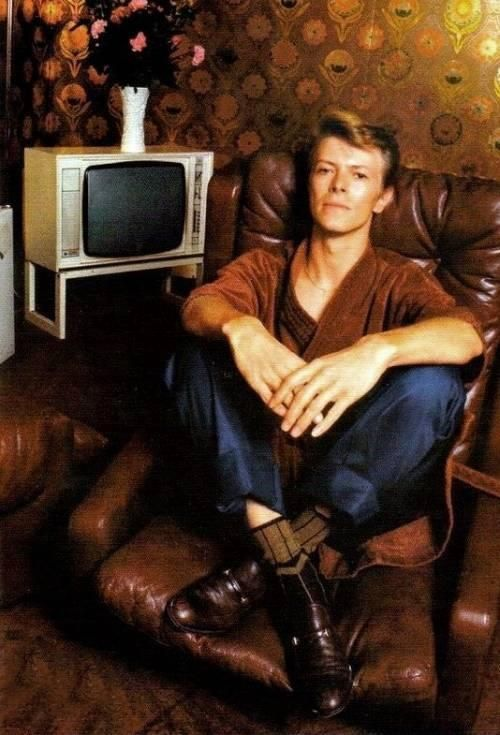 David Bowie watching television. I imagine we would probably talk through all the shows and/or mock them for being stupid.