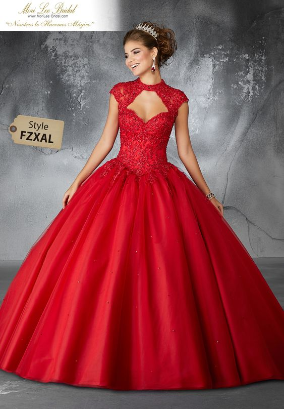 Estilo FZXAL Beaded Lace Appliqués on a Tulle Ballgown with Keyhole Neckline Dramatic and Elegant, This Stunning Quinceañera Dress Features a Beaded Lace, Keyhole Bodice and Full Tulle Skirt. Matching Bolero Jacket Included. Colors: Scarlet, Royal, Blush, White