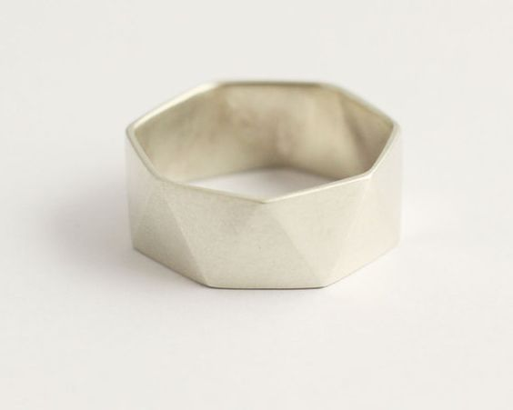 I love that what makes this ring special is the geometry of the ring itself. Matte finish, recycled gold, white gold