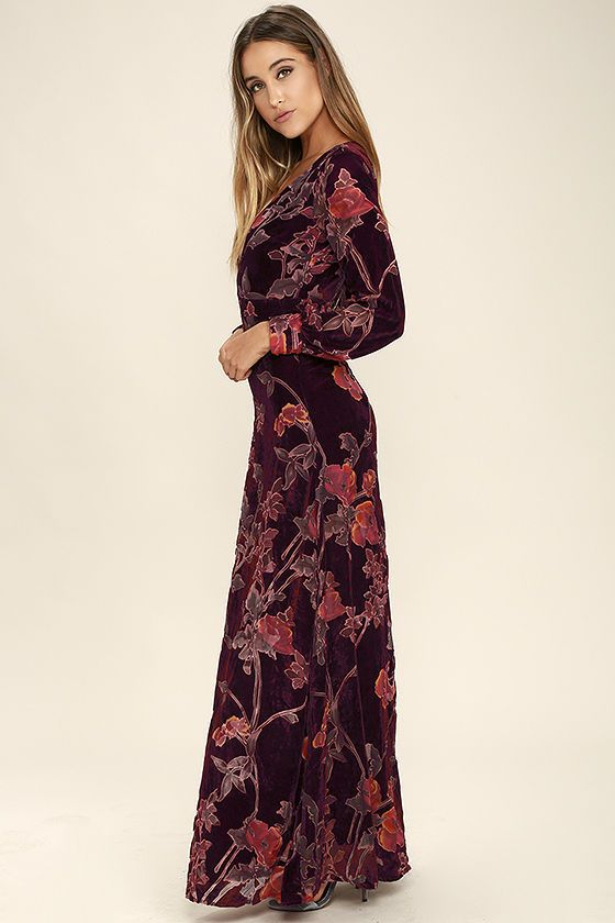 The Practical Magic Burgundy Velvet Floral Print Maxi Dress will have your admirers instantly enchanted! Rich burgundy velvet fabric, with a burnout floral print (in shades of purple, fuchsia, orange, and yellow), forms a darted bodice with a plunging V-neckline framed by long sleeves with buttoning cuffs. Banded waist flows into a maxi skirt below an oversized back keyhole (with top button closure). Hidden back zipper/hook clasp.