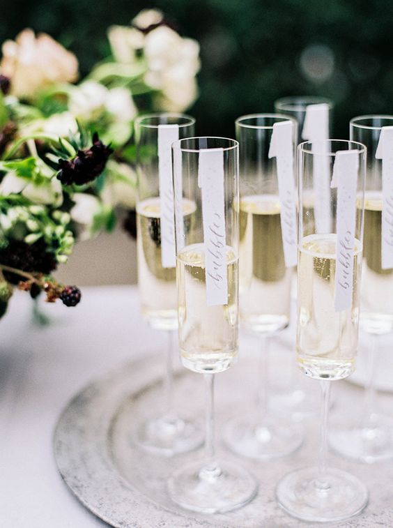 Modern Champagne Flutes with Calligraphy Signs | Sarah Carpenter Photography | Organic Black and White Wedding