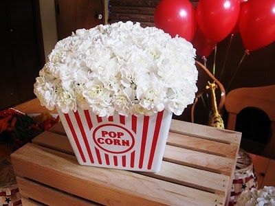 Cute centerpiece for a kid or adult party. White carnations