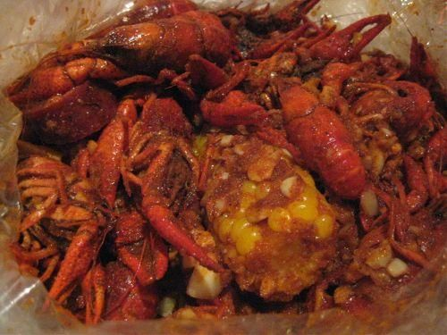 Copycat Boiling Crab Recipe from Food.com:    This recipe attempts to recreate the Cajun crawfish recipe served at Vietnamese restaurants in Little Saigon like The Boiling Crab, Claws, or The Crawfish House.  It's what's known as Asian fusion.  Buy 1-2 pounds of crawfish per person.
