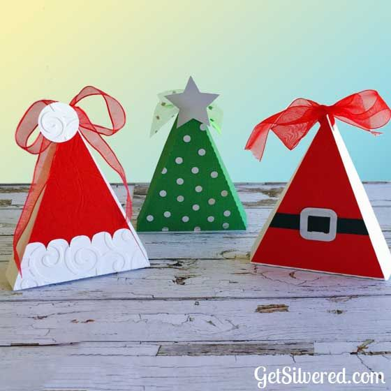 Today I'm sharing two more Christmas cut Files in SVG Format. First up a sweet little Triangle Gift Box that can be decorated 3 ways.  Options are the for a Cute Santa Belt, A Christmas Tree or a Santa Hat. I know this File is popular as there's been nearly 2500 downloads of my Silhouette…