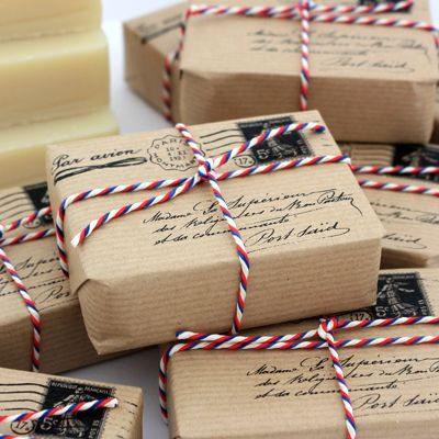 Inspiration: kraft mail inspired gift wrap with airmail baker's twine and mail stamps.